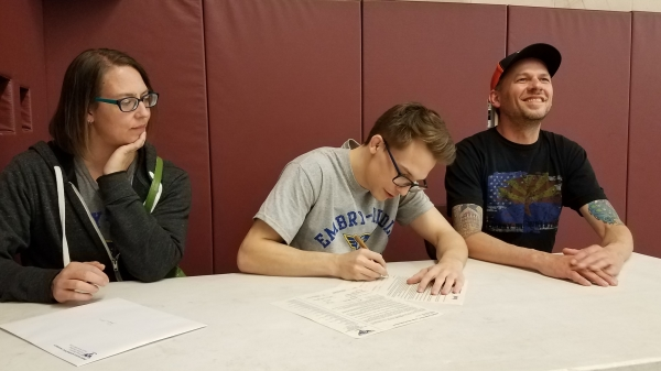 Josh Nira signs his scholarship to Embry-Riddle Aeronautical University